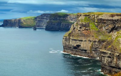 Atlantic ocean with view on Cliffs of Moher in County Clare, Ireland